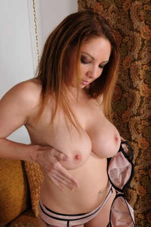 30 plus female Kiki Daire does a sensual striptease in the living room