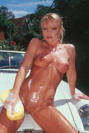 MILF pornstar Silvia Saint soaps up her sexy body in naked outdoor car wash