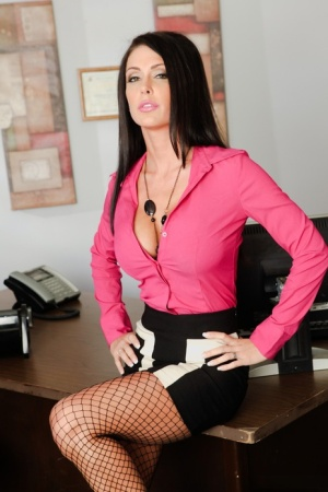 Fully clothed secretary Jessica Jaymes undressing to pose in stockings  heels