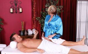 Tattooed masseuse Monroe Valentino bares her firm tits before blowing a client 12228121