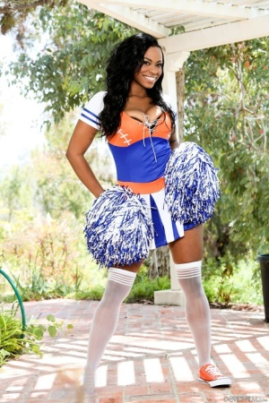 Ebony cheerleader Tori Taylor uncovers boobs  flashes her pussy on patio