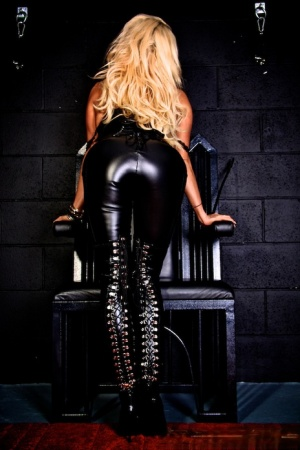 Blonde Dominatrix Dannii Harwood pinches her nipples in latex attire and boots