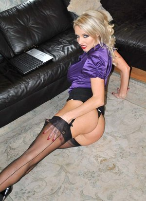 Blonde bombshell Dannii Harwood bares her big boobs and ass in backseam nylons