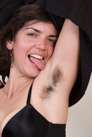 Smiley amateur Katie Z licks hairy armpits and spreads her very furry pussy
