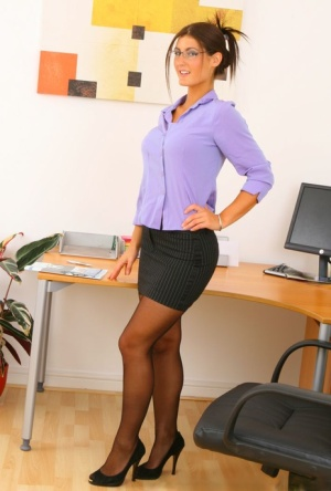 Secretary Emma T unleashes her great tits after removing black miniskirt