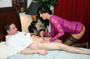 Middle-aged brunette Zoe Holloway jerks her guys cock with her clothes on