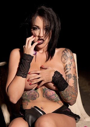Tattooed chick Angelina Valentine removes a gas mask before showing her tits