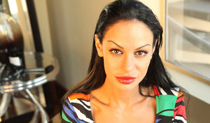 Latin female with long black hair Angelina Valentine fixes her face in mirror
