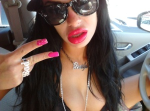 Latina chick Angelina Valentine models non nude in hat and sunglasses