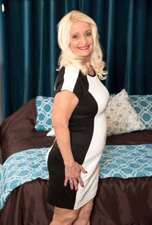Older blonde lady Vikki Vaughn is stripped naked by a younger guy