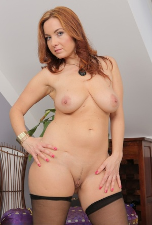 Hot redhead MILF Jessica Red removes sexy lingerie to finger her pussy closeup