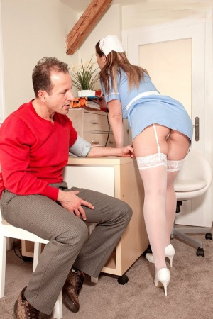 Big titted nurse in uniform Terry Nova gets her saggy boobs sucked by patient