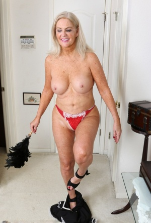 Blonde nan Judy Mayflower steps out of her French maid attire for nude poses 76065929