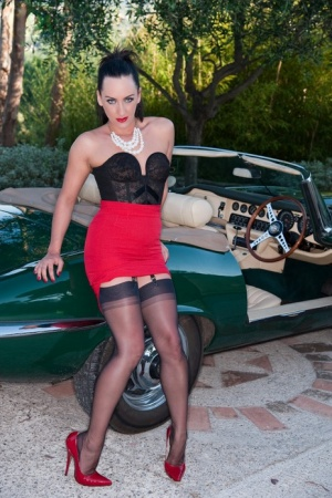 British lady Chloe Lovette parts her slit over the bonnet of a car in nylons