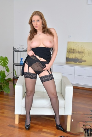 Housewife in high heels and stockings undressing to bare big tits  hot pussy
