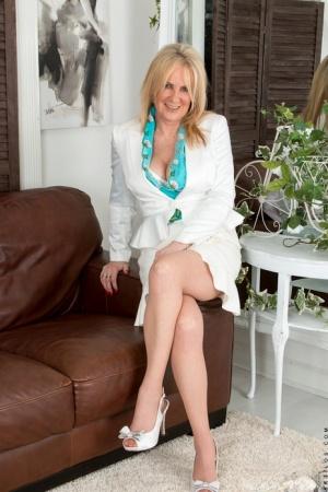 Mature mom with sexy legs in stockings undressing to bare big tits  hot pussy