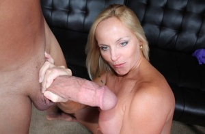 Busty female Dani Dare jerks and sucks off a cock after seducing a man