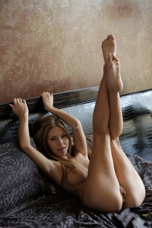 Sexy nubile Ebbi gets hot and masturbates her bald pussy with legs spread wide 86271746