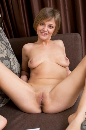 Mature mom in bare feet undressing to show saggy tits  bald beaver