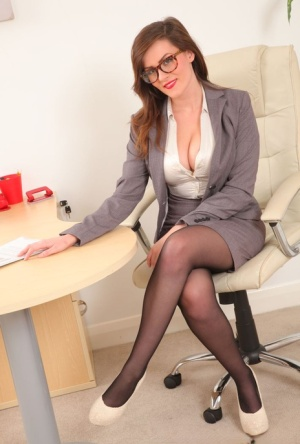 Nerdy secretary Charlie Rose uncovers her firm tits in nylons and garters