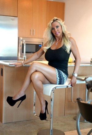 Bare legged wife exposes her huge tits and snatch in a skirt and high heels