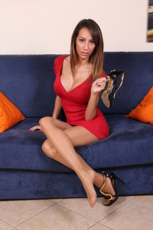 Non nude MILF removes her high heeled shoes from pantyhose encased feet
