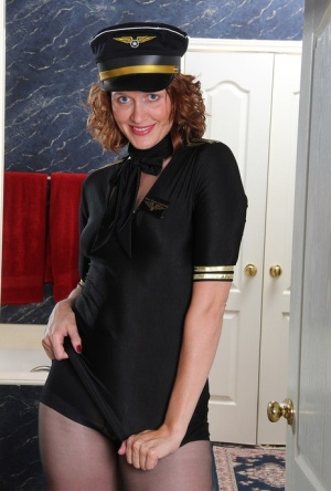 Over 30 woman Roxanne Clemmens strips naked with her pilots cap on