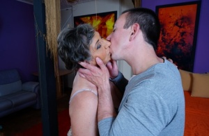 Granny with grey hair greets her toy boy for their regular fuck session