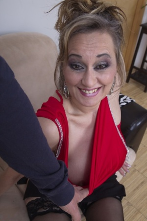 Aging cougar uses her bare big tits to land herself some office cock