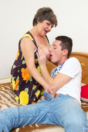 Horny short haired granny gets pleased by a handsome student