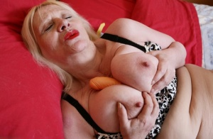 Chubby British nan whips out her large boobs prior to masturbating 86791043