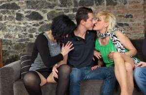 Mature women participate in steamy foreplay with a couple of younger guys