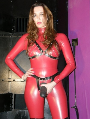 Mature British woman Strapon Jane strokes her faux penis in latex clothing