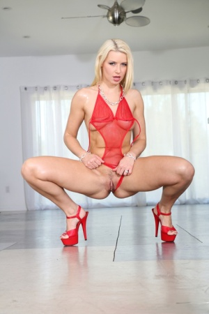 Beautiful blonde Anikka Albrite gets a big cumshot over her round oiled ass