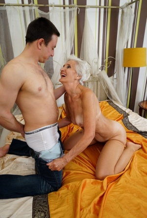 Grey haired granny and her toy boy warm up with foreplay before fucking