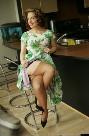 MILF dirty Angie shows long legs in hot upskirt vintage kitchen scene
