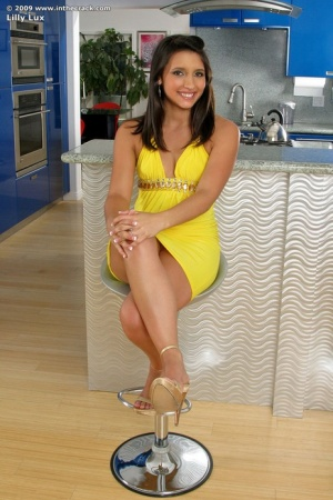 Long legged hot Latina hikes tight dress to toy with banana in the kitchen