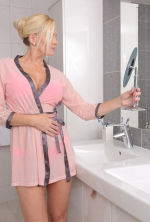 Big titted hot blonde MILF Lilly Peterson toys with huge dildo in the tub