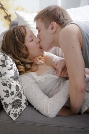 Beautiful female and her man friend remove jeans before lovemaking session