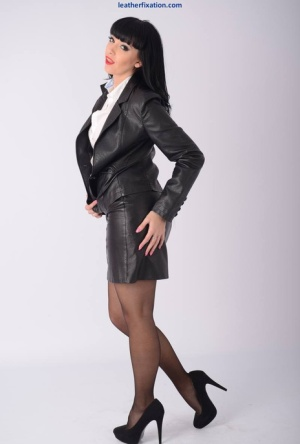 Hot brunette Sammi Jo frees her firm tits in a leather jacket and miniskirt