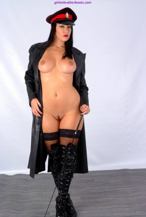 Hot brunette Sammi Jo flashes her naked body in a leather trench coat and cap