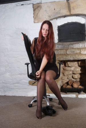 Amateur model with long red hair Sammy dons thigh high leather boots