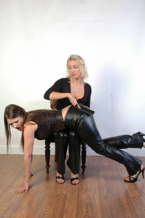 Blonde chick paddles her lesbian lovers ass while they wear leather pants 67939707