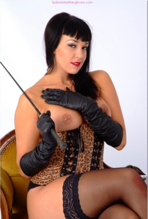 Dark haired beauty Sammi Jo goes topless in a waist cincher and leather gloves