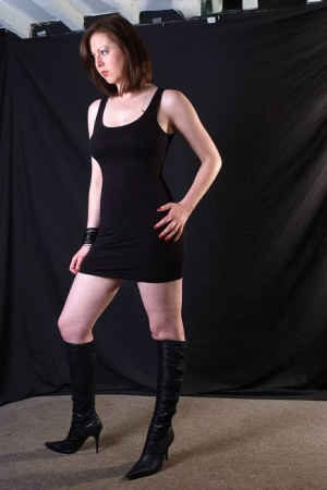 Sophisticated Tracy poses in sexy black dress and boots