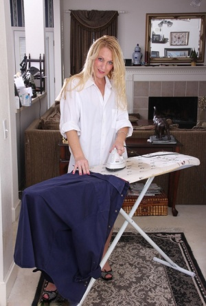 Over 30 housewife with blonde hair strips naked while doing her ironing