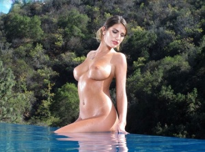 Sexy August Ames baring bug tits  stretching wet shaved pussy to toy in pool
