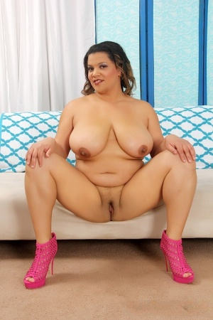 Fat woman Lady Spice disrobes to high heeled footwear before sucking a cock