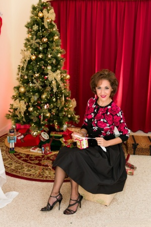 Classy older lady Roni Ford removes vintage attire in front of Christmas tree