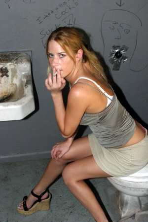 Trashy white girl Lain gags on a black dick at a gloryhole in filthy bathroom
